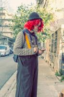 <h2>Clown checking his messages